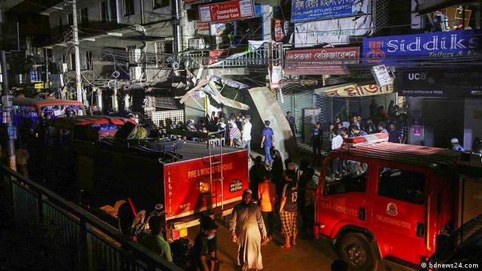 Emergency vehicles respond to the scene of an explosion in Dhaka, Bangladesh