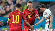 Soccer Football - Euro 2020 - Round of 16 - Belgium v Portugal - La Cartuja Stadium, Seville, Spain - June 27, 2021 Belgium's Thorgan Hazard celebrates scoring their first goal with Eden Hazard Pool via REUTERS/Thanassis Stavrakis