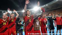 Soccer Football - Euro 2020 - Round of 16 - Belgium v Portugal - La Cartuja Stadium, Seville, Spain - June 27, 2021 Belgium's Axel Witsel and teammates celebrate after the match Pool via REUTERS/Alexander Hassenstein