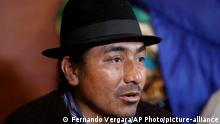 Leonidas Iza, a Quechua leader from mountainous Cotopaxi province, talks during an interview in Quito, Ecuador, Monday, Oct. 14, 2019. Cleanup of the Ecuadorian capital began hours after President Lenín Moreno and indigenous leaders struck a deal late Sunday to cancel a disputed austerity package and end nearly two weeks of protests that paralyzed the Ecuadorian economy and left seven dead. (AP Photo/Fernando Vergara)