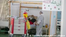 TUNIS, TUNUSIA - JUNE 22: Health workers care Covid-19 patients in a hospital in quarantined Kayravan province of Tunis, Tunisia on June 22, 2021. 4 provinces in Tunisia including Kayravan in the central part of the country, Silyana and Bace in the northwest, and Zagvan province in the south of the capital quarantined due to serious increase in Covid-19 cases. Yassine Gaidi / Anadolu Agency