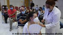 (210626) -- TUNIS, June 26, 2021 (Xinhua) -- A medical worker administers the COVID-19 vaccine to a woman at a vaccination site in Tunis, Tunisia, on June 26, 2021. Since the start of the nationwide vaccination campaign against coronavirus on March 13, a total of 1,705,657 people have received the vaccines, with 476,013 taking both doses, according to the latest figures published by Tunisian Health Ministry. (Photo by Adel Ezzine/Xinhua)