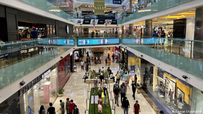 Shoppers fill a New Delhi mall