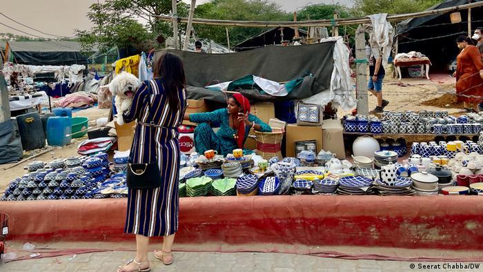 A woman with her dog in Gurgaon's Banjara market