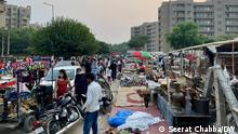 People step out as shops and markets reopen in India's National Capital Region after weeks of a coronavirus-induced lockdown. India has recently seen a fall in cases after reporting one of the world's worst virus outbreaks. Date: June 27, 2021 Credit: Seerat Chabba, DW Location: Gurgaon, India