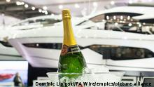London Boat Show 2017. A bottle of champagne is seen alongside a yacht at the London Boat Show at the ExCel centre in London. Picture date: Friday January 6, 2017. The show runs until Sunday 15th January and will feature over 300 exhibitors. Photo credit should read: Dominic Lipinski/PA Wire URN:29630006