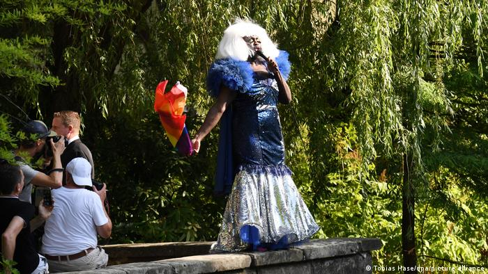A drag performer sings in a park in Bayreuth in 2019.
