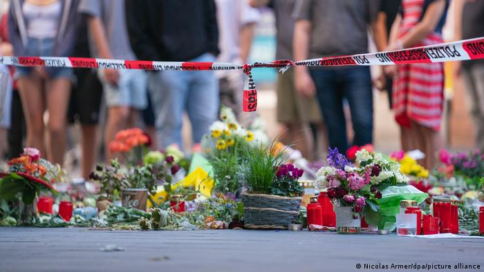 Flowers on the ground in Würzburg on June 25, 2021, after a knife attack in the city center