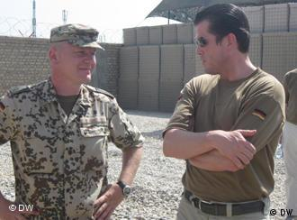 Karl Theodor zu Guttenberg speaks with a German soldier in Kunduz.
