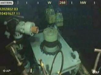 This image taken from video provided by BP PLC at 15:13 CDT shows that oil has stopped flowing from the new 75-ton cap atop the site of the Deepwater Horizon oil spill in the Gulf of Mexico Thursday, July 15, 2010. BP finally choked off the flow of oil into the Gulf of Mexico on Thursday _ 85 days and up to 184 million gallons after the crisis unfolded _ then began a tense 48 hours of watching to see whether the capped-off well would hold or blow a new leak. Engineers will monitor pressure gauges and watch for signs of leaks elsewhere in the well. (AP Photo/BP PLC) NO SALES