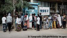 People wait in a line to enter a bank in Mekele, the capital of Tigray region, Ethiopia, on June 25, 2021. (Photo by Yasuyoshi CHIBA / AFP) (Photo by YASUYOSHI CHIBA/AFP via Getty Images)
