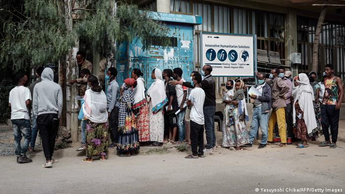 People wait in a line to enter a bank in Mekele, the capital of Tigray region, Ethiopia