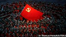 28.06.2021 Performers rally around the Red Flag during a show commemorating the 100th anniversary of the founding of the Communist Party of China at the National Stadium in Beijing, China June 28, 2021. REUTERS/Thomas Peter TPX IMAGES OF THE DAY