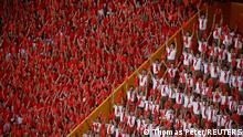 28.06.2021 Spectators attend a performance commemorating the 100th anniversary of the founding of the Communist Party of China at the National Stadium in Beijing, China June 28, 2021. REUTERS/Thomas Peter