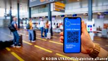 ILLUSTRATIVE - A corona passport with a qr code on a mobile phone at Rotterdam the HAgue airport. With a corona passport (digital Covid-19 certificate), the EU wants to make free travel between member states easier. With the 'Digital Green Pass' you can show that you have been vaccinated, recently tested negative or already recovered from corona. More and more countries are going yellow for the holidays. Robin Utrecht
