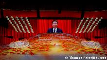 """***Dieses Bild ist fertig zugeschnitten als Social Media Snack (für Facebook, Twitter, Instagram) im Tableau zu finden: Fach """"Images"""" —> Weltspiegel/Bilder des Tages*** A screen shows Chinese President Xi Jinping during a show commemorating the 100th anniversary of the founding of the Communist Party of China at the National Stadium in Beijing, China June 28, 2021. REUTERS/Thomas Peter TPX IMAGES OF THE DAY"""