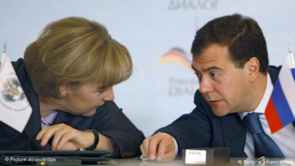 Merkel and Medvedev chatting at Petersburg Dialogue