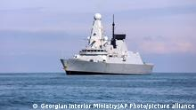 26.06.21 *** FILE - In this Saturday, June 26, 2021 file photo, released by the Georgian Interior Ministry, British destroyer HMS Defender arrives at the port of Batumi, Georgia. Sensitive defense documents containing details about the British military have reportedly been found at a bus stop in England. The BBC reported Sunday, June 27, 2021 that the papers included plans for a possible U.K. military presence in Afghanistan. They also included discussion about the potential Russian reaction to the British warship HMS Defender's travel through waters off the Crimea coast last week. (Georgian Interior Ministry via AP, File)