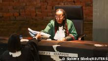 Judge Sisi Khampepe hands over documents after giving a ruling on whether former South African President Jacob Zuma should be punished for defying summons at an inquiry into corruption during his time in power, at the Constitutional Court in Johannesburg, South Africa, June 29, 2021. REUTERS/Siphiwe Sibeko
