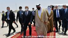 ABU DHABI, UNITED ARAB EMIRATES - JUNE 29: (----EDITORIAL USE ONLY – MANDATORY CREDIT - ISRAELI FOREIGN MINISTRY / HANDOUT - NO MARKETING NO ADVERTISING CAMPAIGNS - DISTRIBUTED AS A SERVICE TO CLIENTS----) Israeli Foreign Minister, Yair Lapid (Front L) is welcomed by Minister of State to the United Arab Emirates, Ahmed Ali Al Sayegh (Front R) upon arrival in Abu Dhabi Airport on June 29, 2021 in Abu Dhabi, United Arab Emirates. Yair Lapid is the first minister to visit UAE following the normalization deal between the two countries. Israeli Prime Ministry / Handout / Anadolu Agency