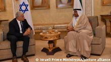 ABU DHABI, UNITED ARAB EMIRATES - JUNE 29: (----EDITORIAL USE ONLY – MANDATORY CREDIT - ISRAELI FOREIGN MINISTRY / HANDOUT - NO MARKETING NO ADVERTISING CAMPAIGNS - DISTRIBUTED AS A SERVICE TO CLIENTS----) Israeli Foreign Minister Yair Lapid (L) chats with Minister of State to the United Arab Emirates, Ahmed Ali Al Sayegh (R) upon arrival in Abu Dhabi Airport on June 29, 2021 in Abu Dhabi, United Arab Emirates. Yair Lapid is the first minister to visit UAE following the normalization deal between the two countries. Israeli Prime Ministry / Handout / Anadolu Agency
