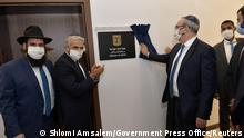 Israeli Foreign Minister Yair Lapid applauds as a plaque is revealed during an inauguration ceremony of Israel's embassy in Abu Dhabi, United Arab Emirates June 29, 2021. Shlomi Amsalem/Government Press Office (GPO)/Handout via REUTERS. THIS IMAGE HAS BEEN SUPPLIED BY A THIRD PARTY.MANDATORY CREDIT.