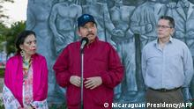 Handout picture released by Nicaraguan Presidency shows Nicaraguan President Daniel Ortega (C), Vice-President Rosario Murillo (L) and Carlos Fonseca Teran (R) attending to the anniversary ceremony of Sandinista leader Carlos Fonseca Amador birth at the Plaza de la Revolución in Managua on June 23, 2021. - Nicaraguan President Daniel Ortega, assured on Wednesday that the 19 opposition members imprisoned five months before the elections are not candidates or politicians but criminals who attempted against the security of the country by trying to organize a coup d'état. (Photo by Handout / Nicaraguan Presidency / AFP) / RESTRICTED TO EDITORIAL USE - MANDATORY CREDIT AFP PHOTO / NICARAGUAN PRESIDENCY / CESAR PEREZ - NO MARKETING - NO ADVERTISING CAMPAIGNS - DISTRIBUTED AS A SERVICE TO CLIENTS