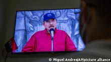 A man watches a televised national address by Nicaraguan President Daniel Ortega, at his home in Managua, Nicaragua, Wednesday, June 23, 2021. The president of the Inter-American Commission on Human Rights Antonia Urrejola says that Nicaragua has entered a new phase of repression with at least 20 opposition figures arrested in recent weeks and constant human rights violations. (AP Photo/Miguel Andres)
