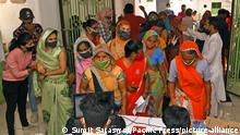 Women beneficiaries stand in queues to receive COVID-19 Vaccine during a special vaccination drive at a mosue in Beawar. Rajasthan government allowed all religious places to reopen from Monday with strict Covid protocols. (Photo by Sumit Saraswat/Pacific Press)
