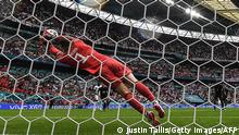 Germany's goalkeeper Manuel Neuer dives to save a shot from England's forward Raheem Sterling during the UEFA EURO 2020 round of 16 football match between England and Germany at Wembley Stadium in London on June 29, 2021. (Photo by JUSTIN TALLIS / AFP) (Photo by JUSTIN TALLIS/AFP via Getty Images)