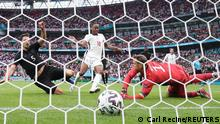 Soccer Football - Euro 2020 - Round of 16 - England v Germany - Wembley Stadium, London, Britain - June 29, 2021 England's Raheem Sterling scores their first goal past Germany's Manuel Neuer REUTERS/Carl Recine