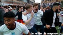 Soccer Football - Euro 2020 - Fans gather for England v Germany - London, Britain - June 29, 2021 England fans celebrate in Vinegar Yard after England's Raheem Sterling scored their first goal REUTERS/Andrew Couldridge