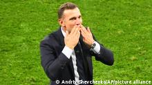 Ukraine's manager Andriy Shevchenko celebrates victory after the Euro 2020 soccer championship round of 16 match between Sweden and Ukraine at Hampden Park stadium in Glasgow, Tuesday, June 29, 2021.(AP Photo/Andy Buchanan, Pool)