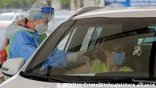 (210429) -- BUCHAREST, April 29, 2021 (Xinhua) -- A person gets a vaccine at a drive-through vaccination center at the Constitution Square in Bucharest, Romania, April 29, 2021. Bucharest's first drive-through vaccination center against COVID-19 was open on Thursday. (Photo by Cristian Cristel/Xinhua)
