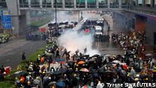 Anti-extradition bill protesters react after tear gas was fired by riot police during a protest to demand democracy and political reforms, at Tsuen Wan, in Hong Kong, China August 25, 2019. REUTERS/Tyrone Siu/File photo SEARCH YIK SECURITY FOR THIS STORY. SEARCH WIDER IMAGE FOR ALL STORIES