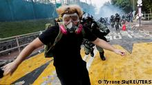 A university student runs from riot police at the Chinese University of Hong Kong, Hong Kong, China November 12, 2019. REUTERS/Tyrone Siu/File photo SEARCH YIK SECURITY FOR THIS STORY. SEARCH WIDER IMAGE FOR ALL STORIES