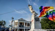 Demonstrators tear down a statue of Italian explorer Cristobal Colon, also known as Christopher Columbus, during protests, in Barranquilla, Colombia June 28, 2021. Picture taken June 28, 2021. REUTERS/Mery Granados NO RESALES. NO ARCHIVES TPX IMAGES OF THE DAY