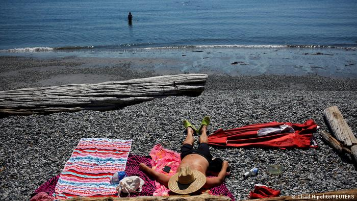 People cool off on the beach in Victoria, British Columbia
