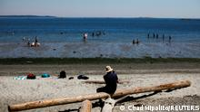 People look for ways to cool off at Willow's Beach during the 'heat dome,' currently hovering over British Columbia and Alberta as record-setting breaking temperatures scorch the province and in Victoria, British Columbia, Canada June 28, 2021. REUTERS/Chad Hipolito