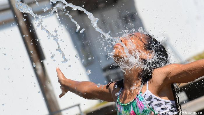 A girl cools off at a community water park in Richmond, British Columbia