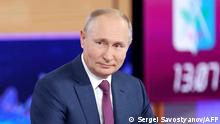 Russian President Vladimir Putin attends an annual televised phone-in with the country's citizens Direct Line with Vladimir Putin at the Moscow's World Trade Center studio in Moscow on June 30, 2021. (Photo by Sergei SAVOSTYANOV / SPUTNIK / AFP)