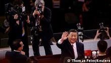 Chinese President Xi Jinping waves to spectators after a show commemorating the 100th anniversary of the founding of the Communist Party of China at the National Stadium in Beijing, China June 28, 2021. REUTERS/Thomas Peter
