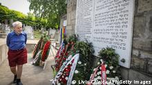 Michael Cernea, 89, an American Jew born in Romania, is pictured visiting the monument of the victims of the Iasi pogrom at the Jewish cemetery in the city of Iasi, Romania, on June 29, 2021. - Cernea was 9 when he witnessed the horrors of the Iasi pogrom and he is one of the very few survivors. Romania commemorates the 80th anniversary of the Iasi pogrom initiated by the Romanian governmental forces under Marshal Ion Antonescu in the city of Iasi, northeastern Romania, against its Jewish comunity. According to Romanian authorities around 15,000 Romanian jews were massacred in the pogrom itself or in its aftermath and many jews were deported. (Photo by Liviu Chirica / AFP) (Photo by LIVIU CHIRICA/AFP via Getty Images)