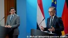 German Foreign Minister Heiko Maas, right, and Yemen's Foreign Minister Ahmad Awad bin Mubarak, left, address the media during a joint press conference prior to a meeting at the foreign ministry in Berlin, Germany, Wednesday, June 30, 2021. (AP Photo/Michael Sohn, pool)