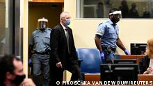 Subordinate of former head of Serbia's state security service Jovica Stanisic, Franko Frenki Simatovic, appears in court at the UN International Residual Mechanism for Criminal Tribunals (IRMCT) in The Hague, Netherlands June 30, 2021. REUTERS/Piroschka van de Wouw/Pool