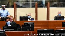 Former head of Serbia's state security service Jovica Stanisic and his subordinate Franko Frenki Simatovic appear in court at the UN International Residual Mechanism for Criminal Tribunals (IRMCT) in The Hague, Netherlands June 30, 2021. REUTERS/Piroschka van de Wouw/Pool