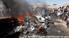 Yemenis gather around burning wreckage of a drone in the country's capital Sanaa, on October 1, 2017. A drone crashed at the northern exit of the Yemeni capital without causing casualties and the Houthis rebels claimed that it had been shot down by their anti-aircraft defense. / AFP PHOTO / MOHAMMED HUWAIS (Photo credit should read MOHAMMED HUWAIS/AFP via Getty Images)