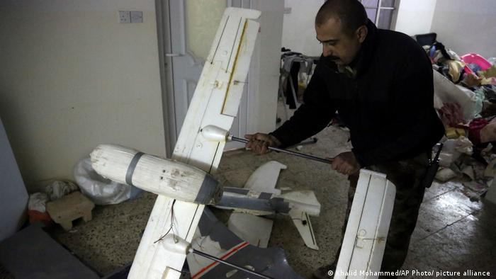 Islamic State drone being examined by an Iraqi security official