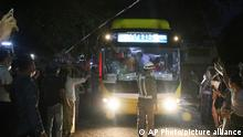 A bus with released prisoners onboard is driven out of Insein Prison in Yangon, Myanmar, Wednesday, June 30, 2021. Myanmar's government began releasing about 2,300 prisoners on Wednesday, including activists who were detained for protesting against the military's seizure of power in February and journalists who reported on the protests, officials said. (AP Photo)