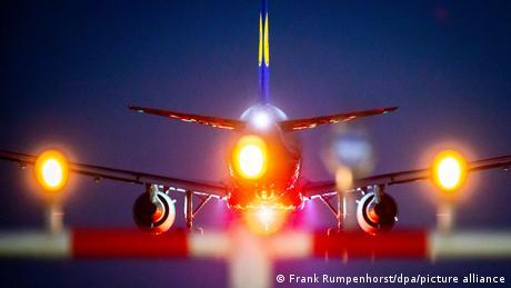 A plane landing at night at Frankfurt airport, Germany